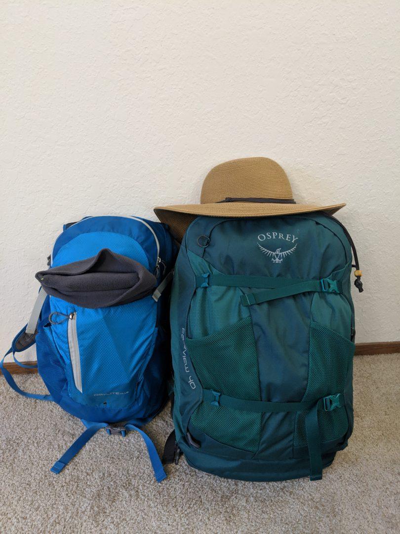Two backpacks sitting on floor.