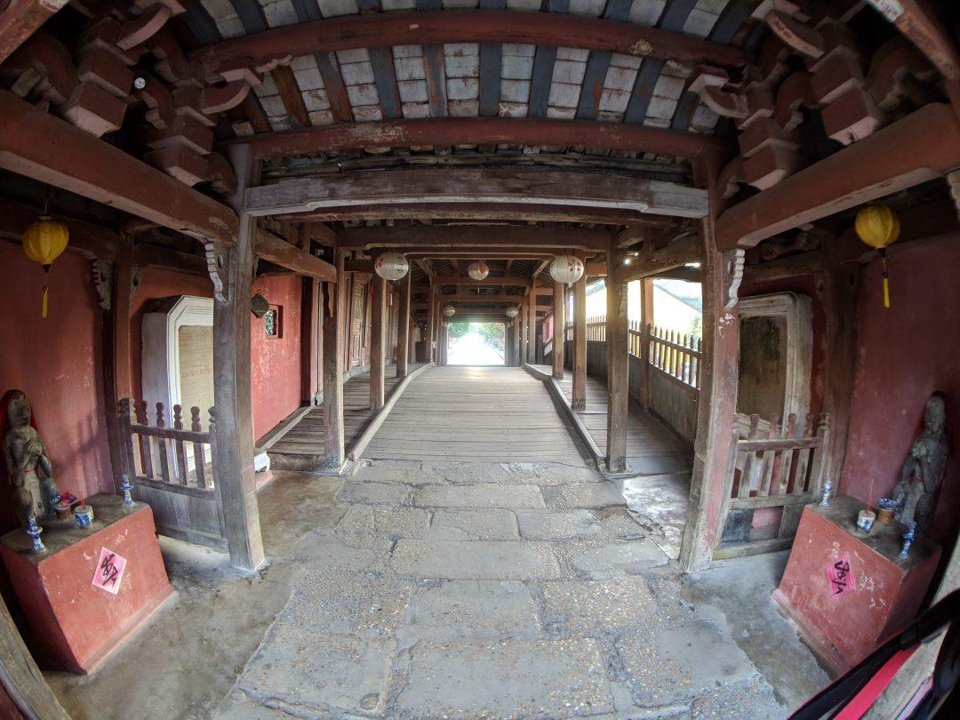 Covered walkway inside the Hoi An Japanese bridge.