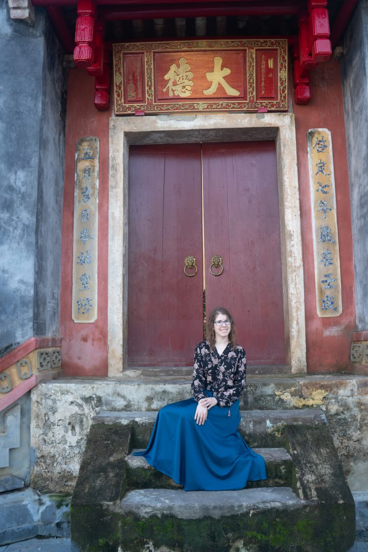 Woman sitting in custom tailored skirt Hoi An