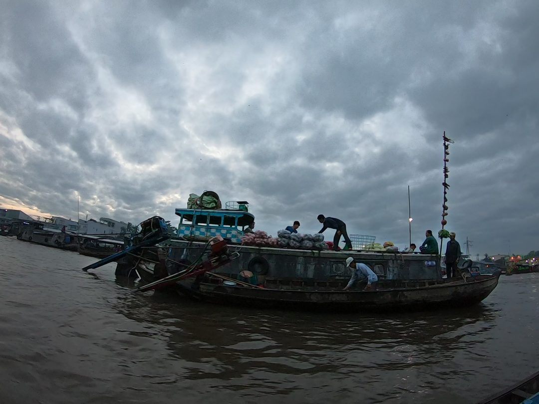 Boat selling produce on Mekong Delta river