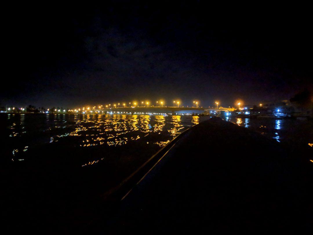 Lights along the Mekong Delta river at night.