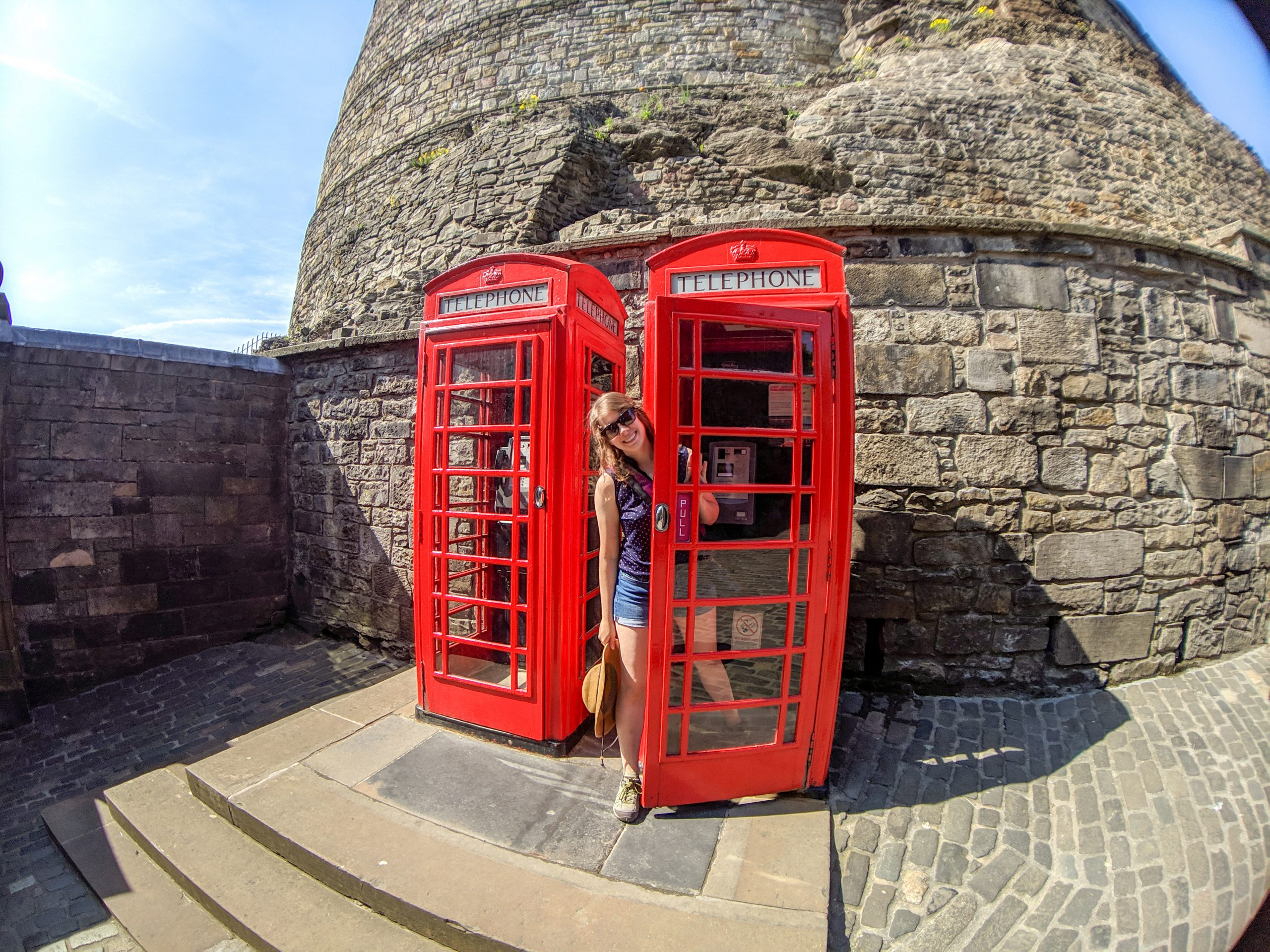 Woman in iconic UK red phone booth