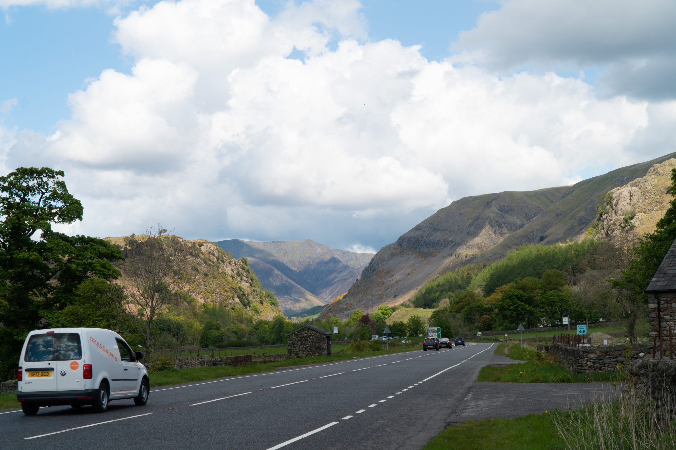 Campervan driving into mountains