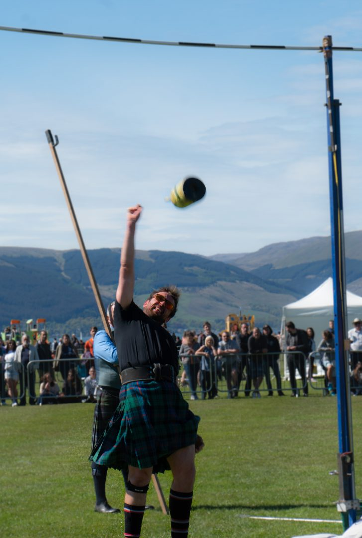 Weight toss competition at The Highland Games in Scotland