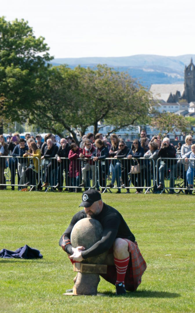 Heavyweight boulder carry competition at The Highland Games in Scotland