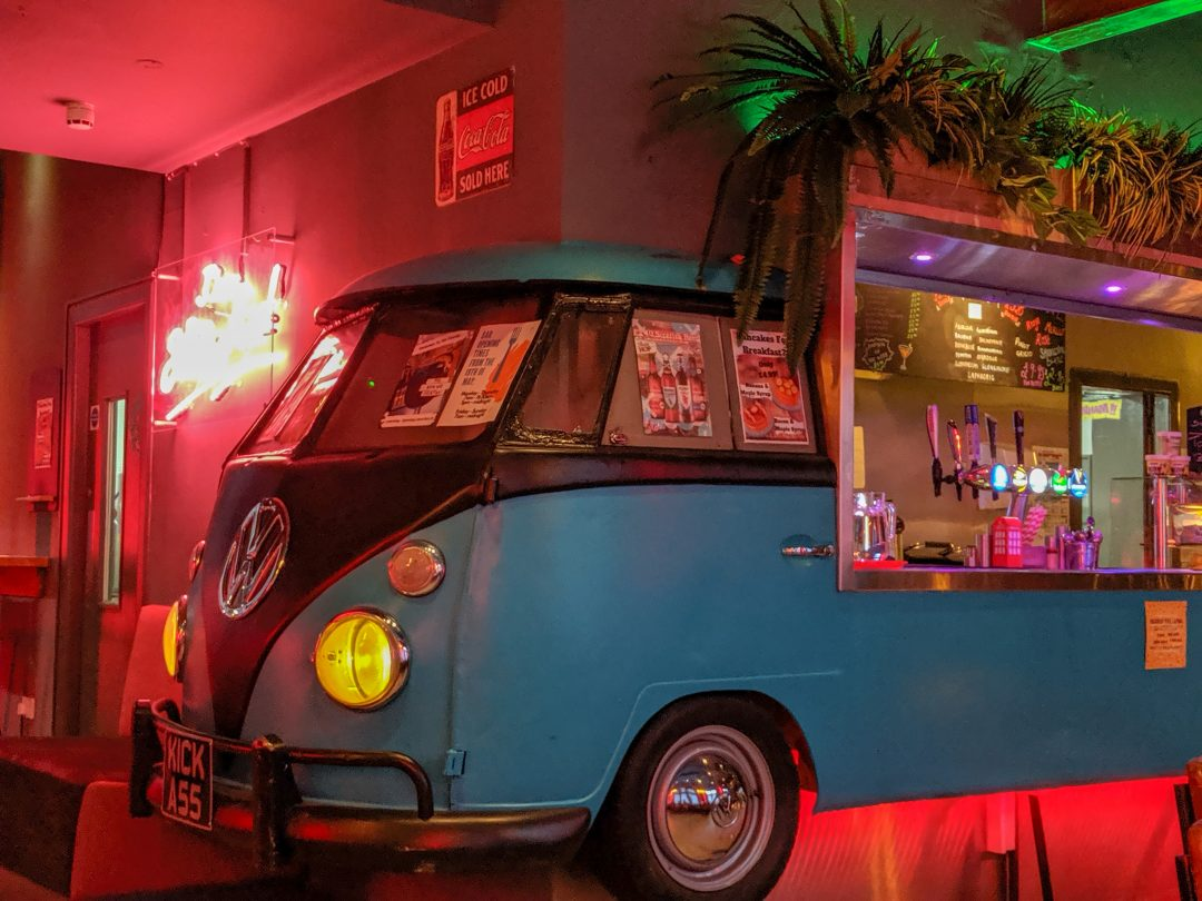 Bar made from A Volkswagon car in the Kick Ass Hostel common room