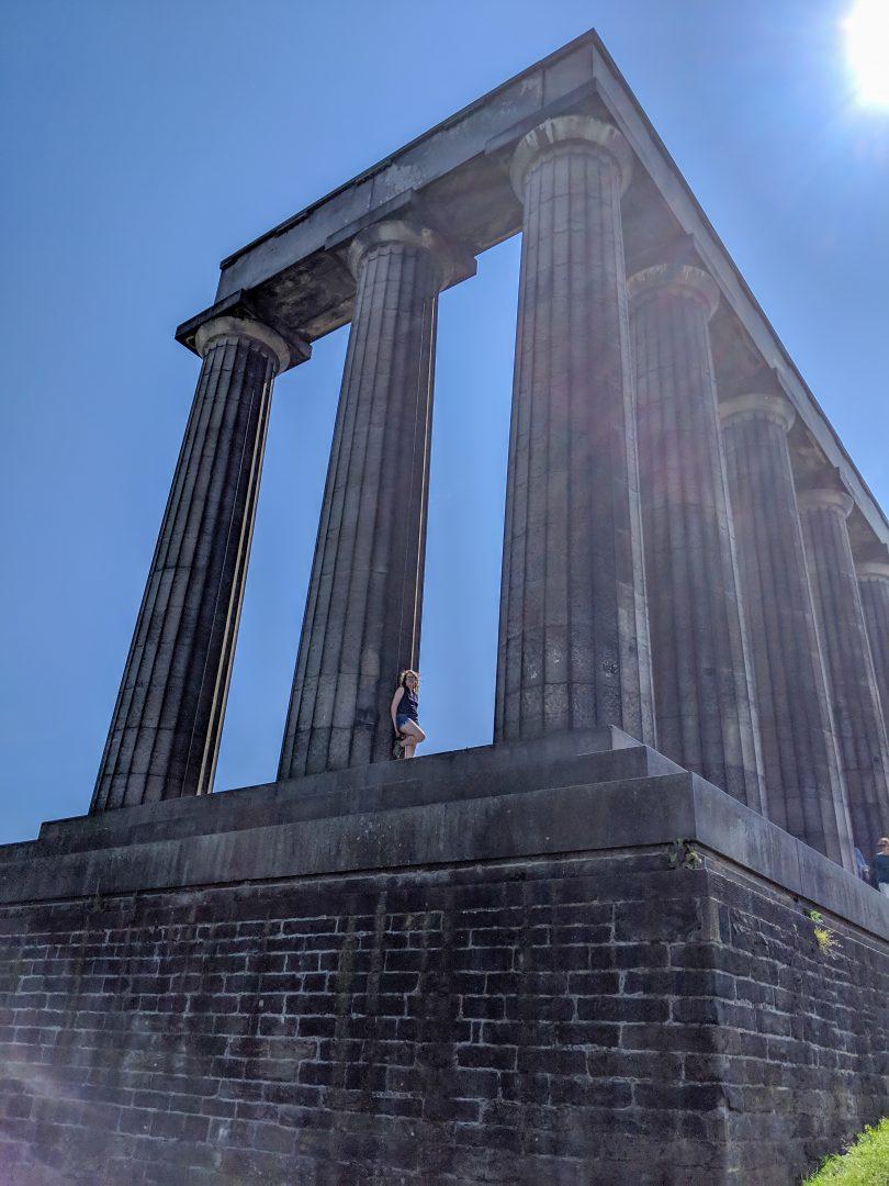 Woman standing on Conic Hill Memorial Edinburgh