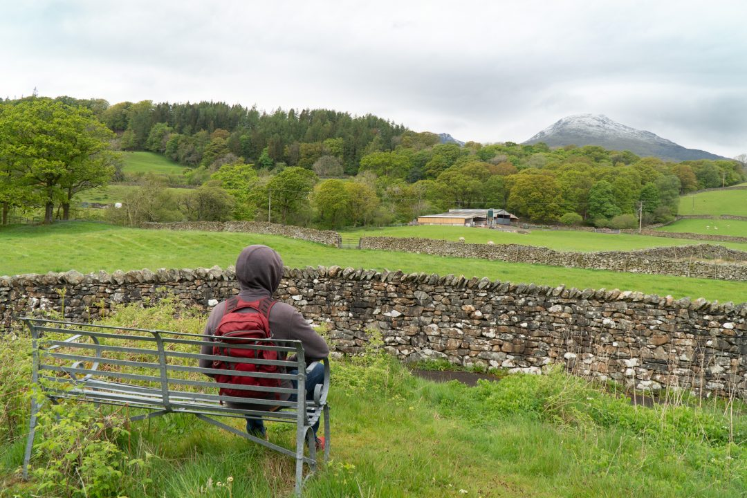 Man sitting on a bench in the countryside