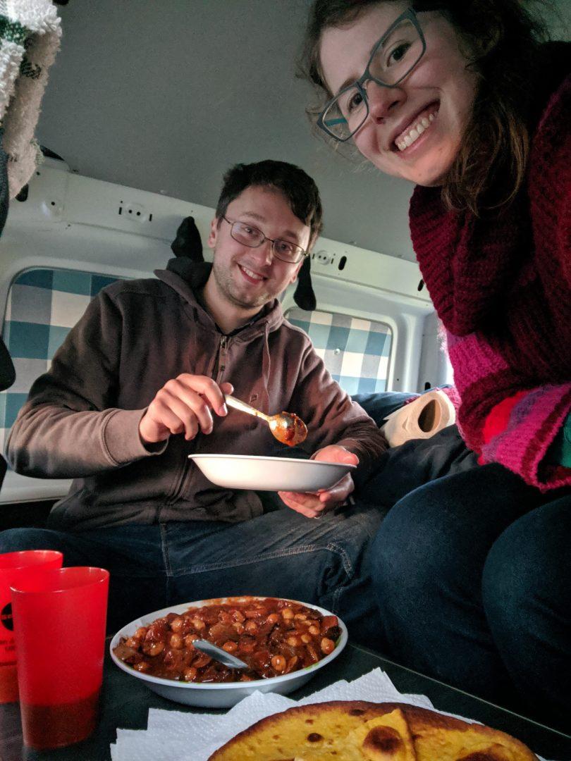 Couple eating dinner in campervan