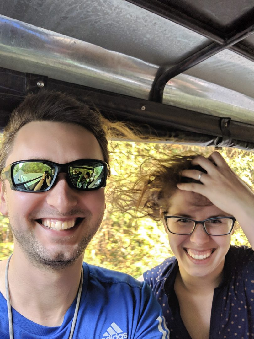 Couple with wind whipping through hair