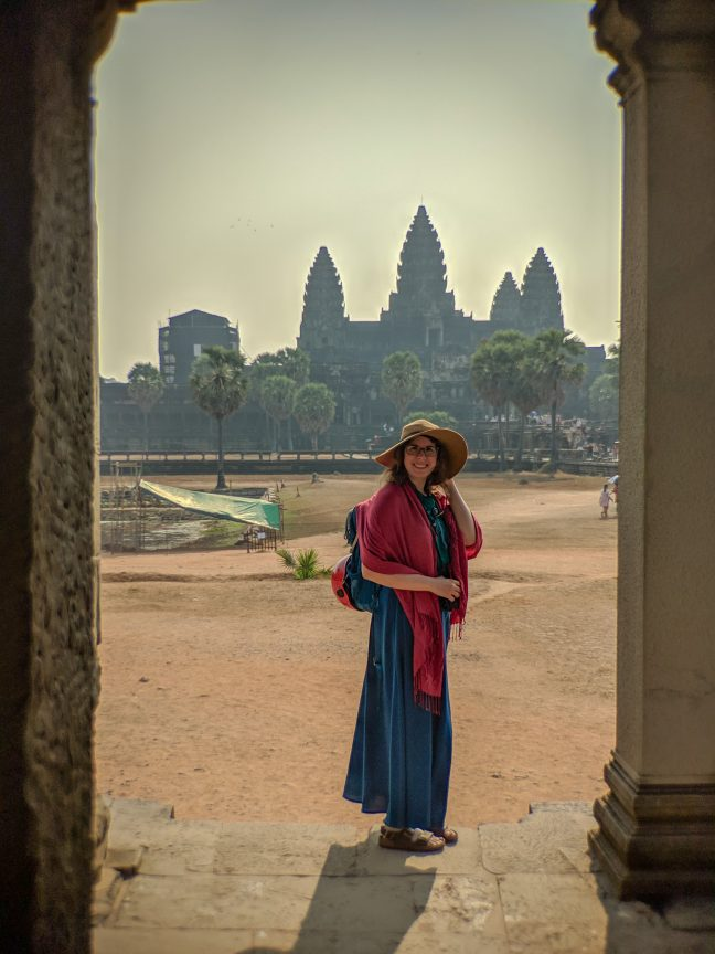 Woman standing outside Angkor Wat