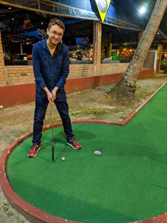 Man playing goofy golf