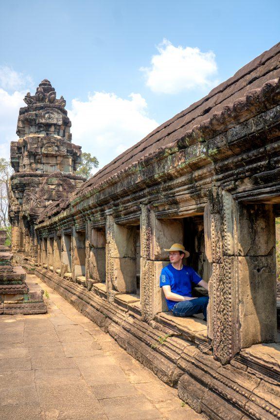 Man exploring Baphuon Temple.