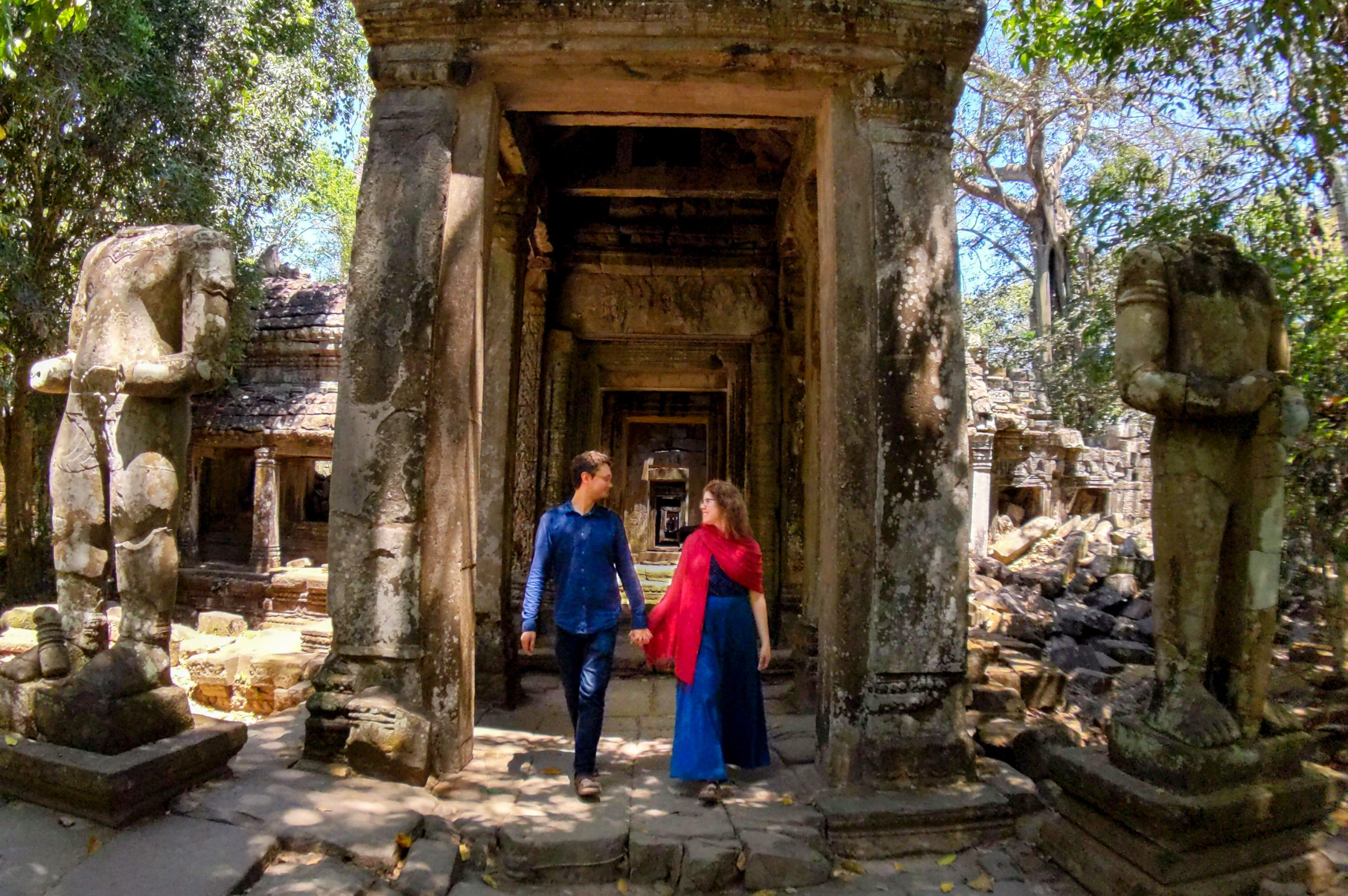 Couple exploring Preah Khan temple at Angkor Archaeological Complex