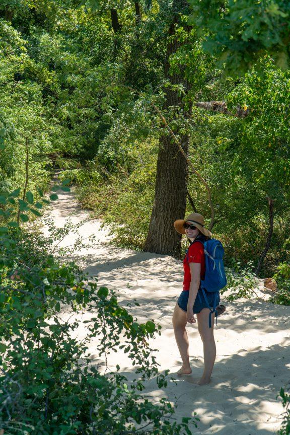 Woman walking barefoot in Letea Forest Romania