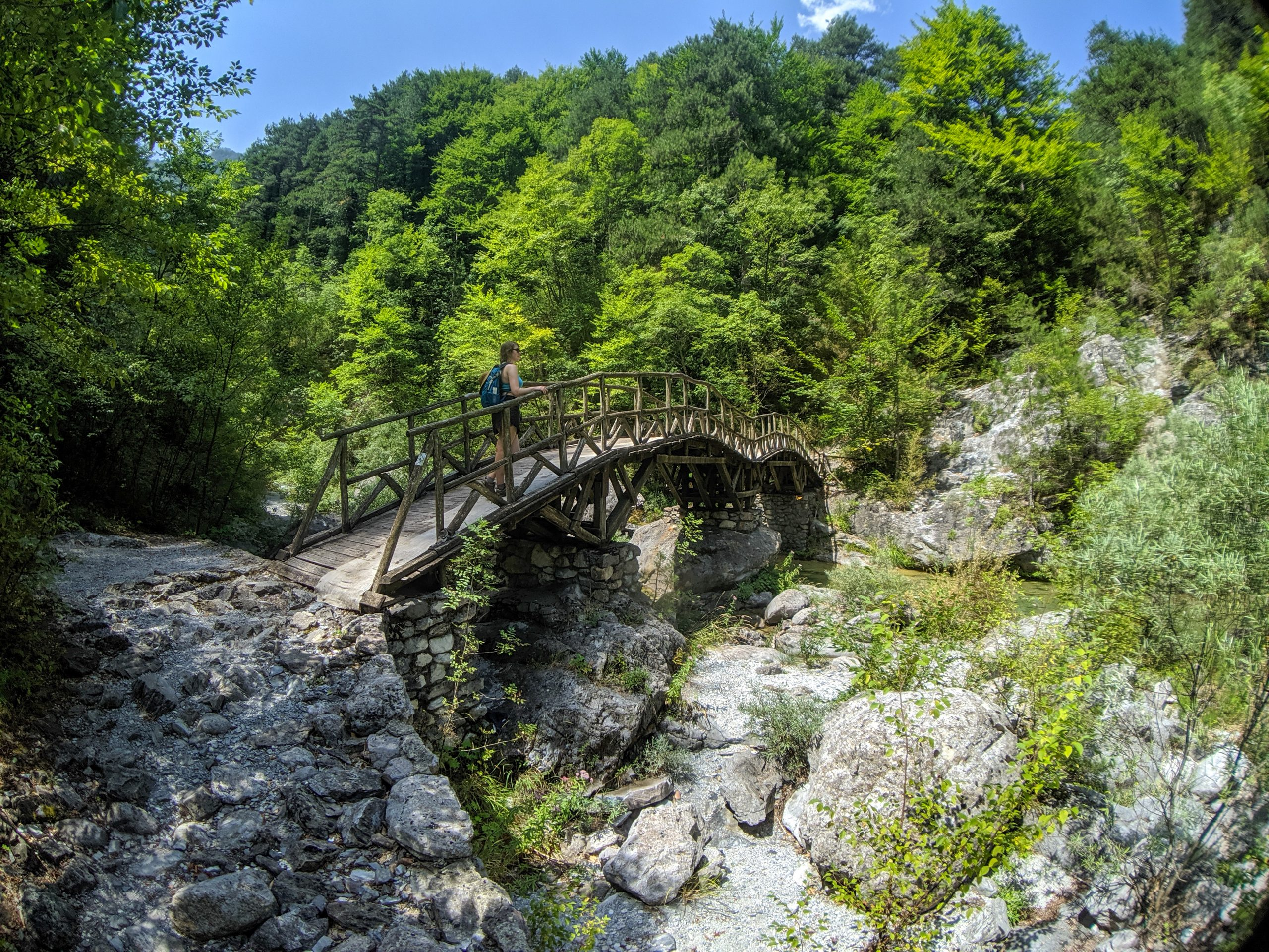Woman on bridge on hiking trail in Greece