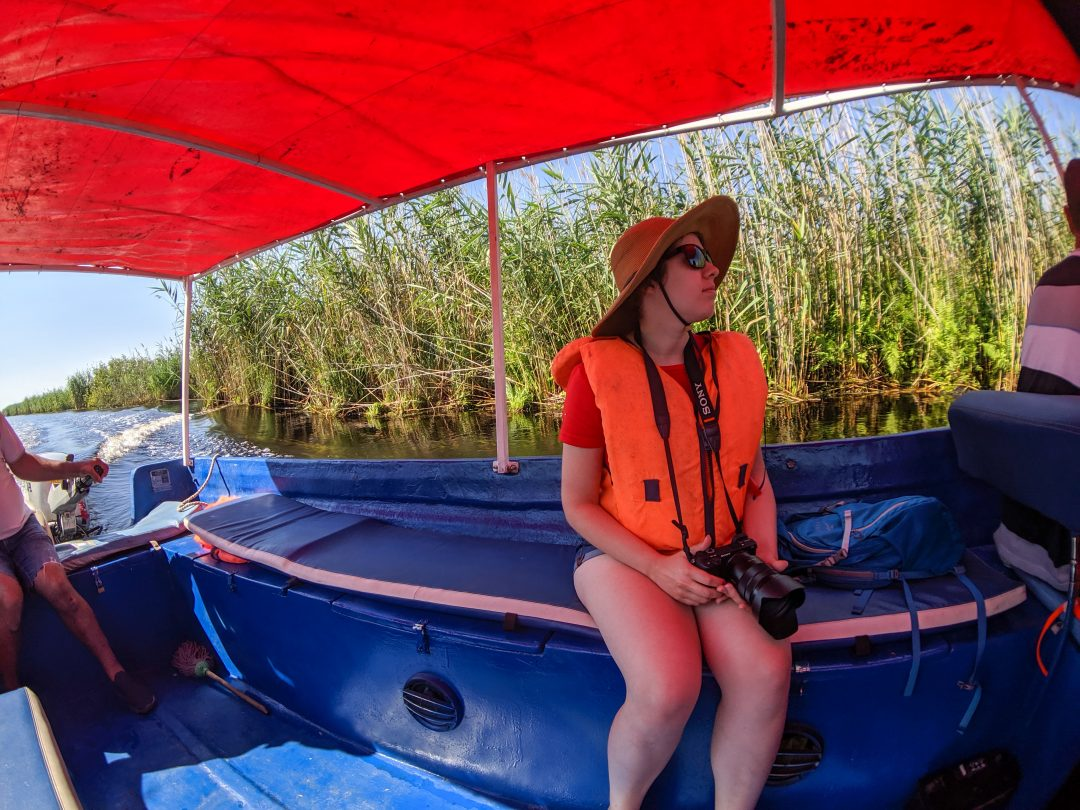 Woman in lifevest on Danube Delta boat tour