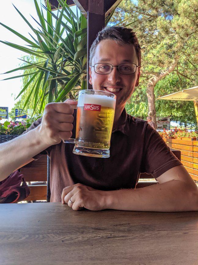 Man drinking an Ursus Beer in Sulina