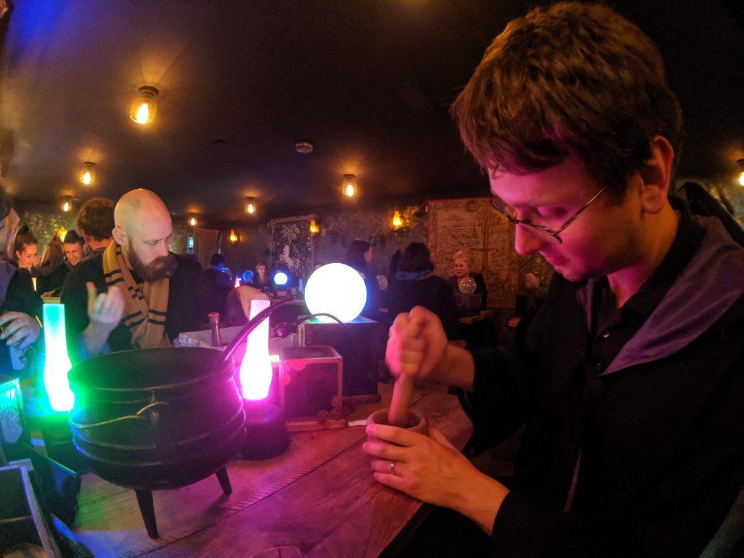 Man mixing potions at The Cauldron