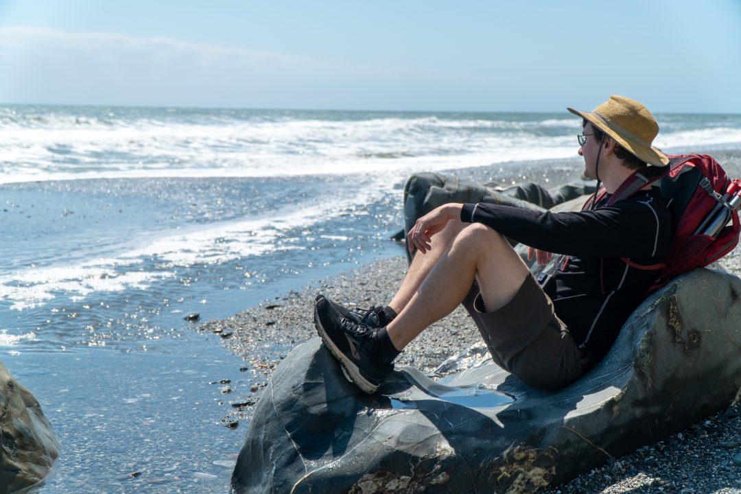Man at beach with sunhat
