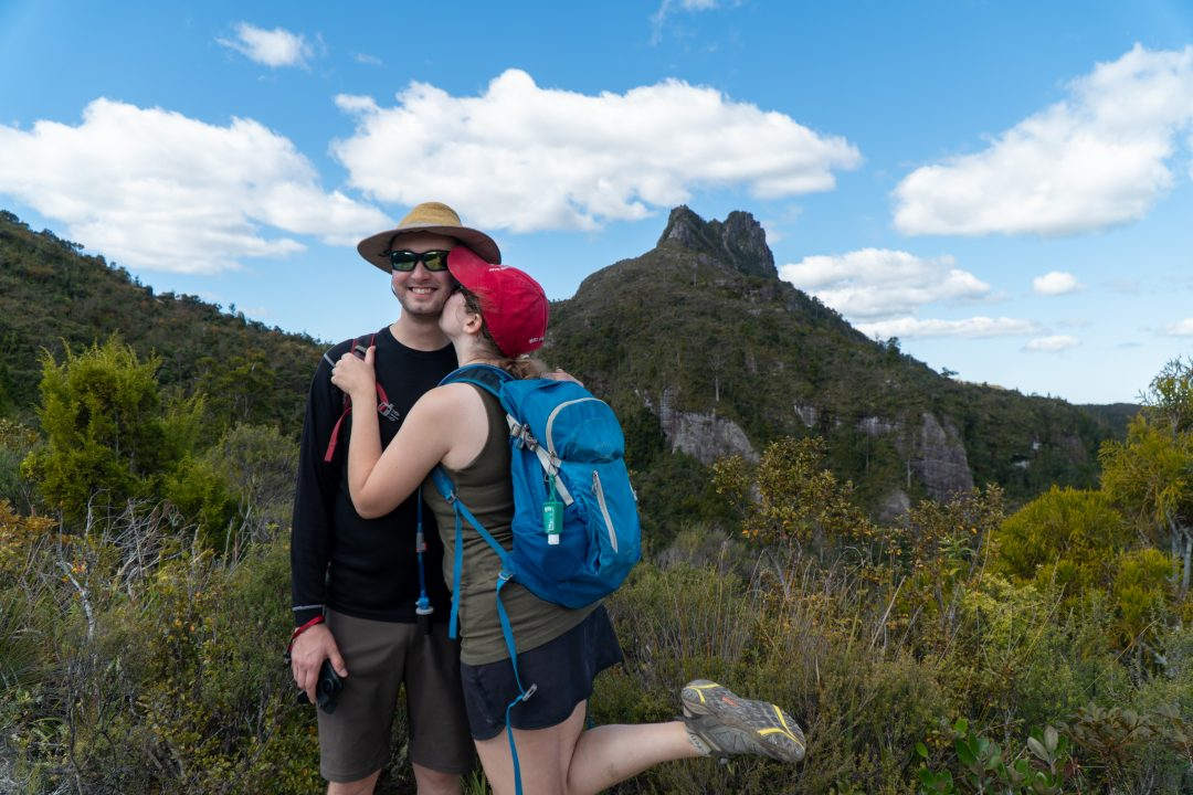 couple kissing on pinnacles walk track Coromandel Peninsula.