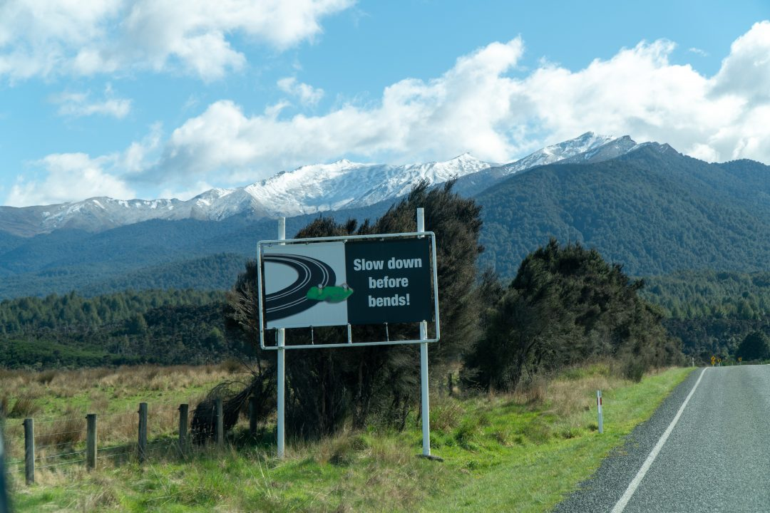 Slow down roadway sign in New Zealand