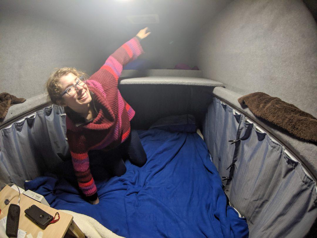 Woman making campervan bed
