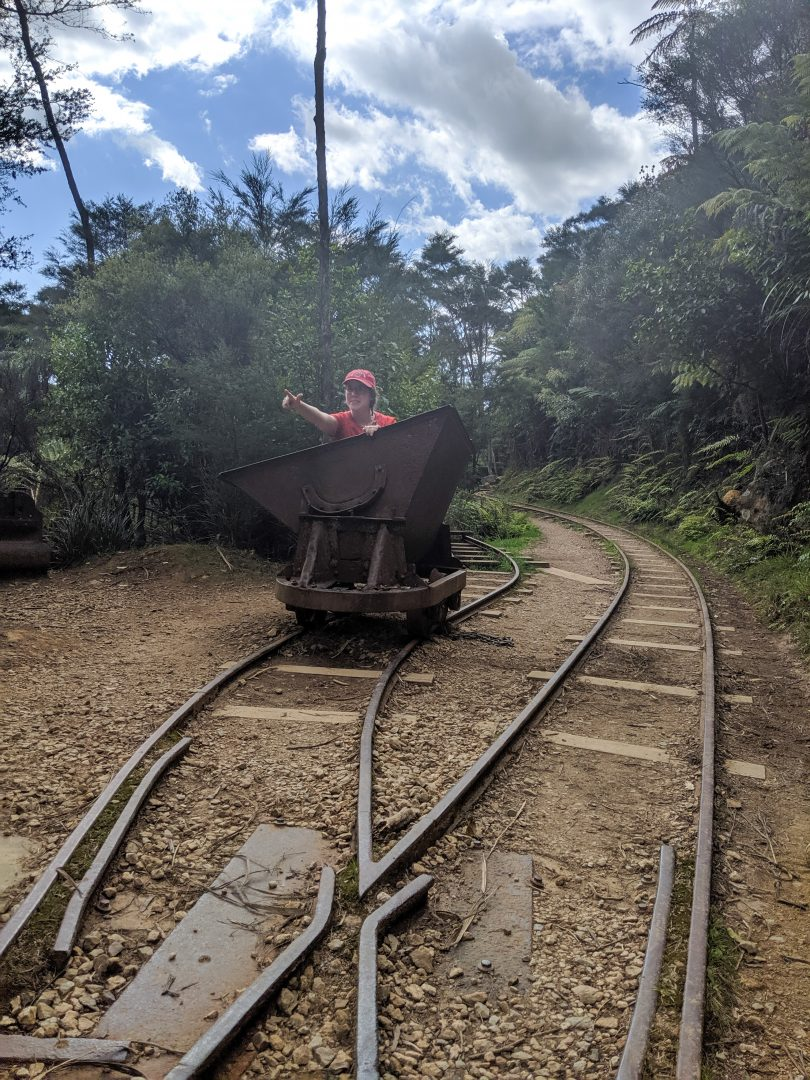 Woman riding in old mining cart