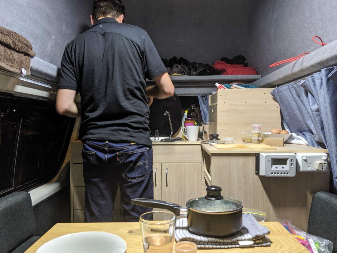 Man cooking in Euro Sky Campervan