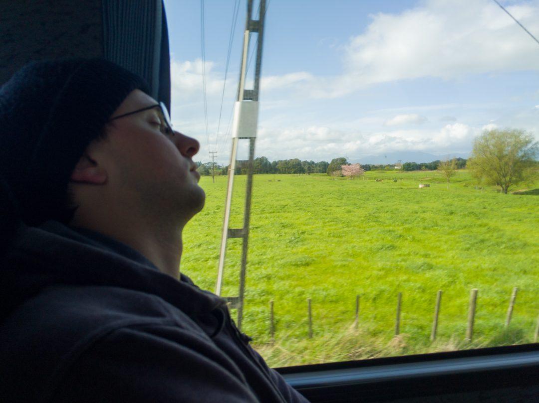 Man sleeping on Intercity bus while traveling New Zealand