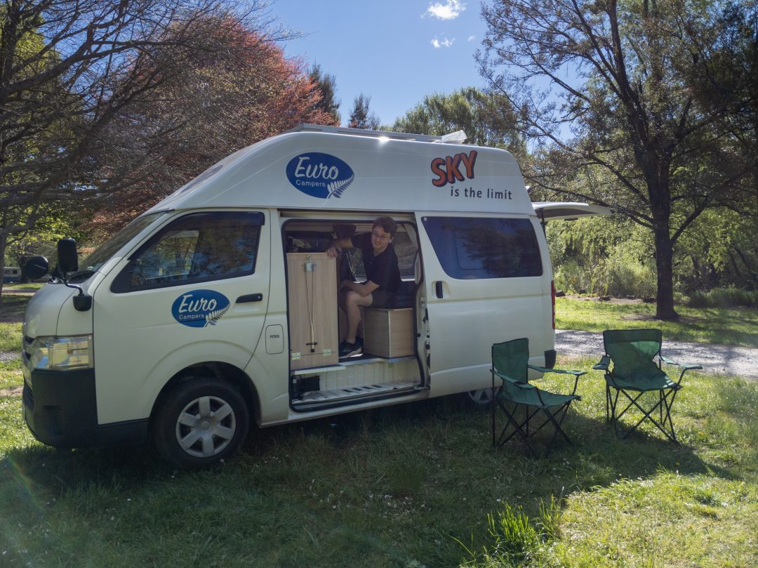 Man freedom camping in New Zealand campervan.
