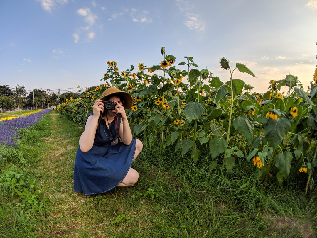 Woman taking photo in garden